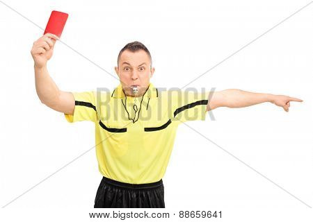 Angry football referee in a yellow jersey showing a red card and pointing with his hand isolated on white background