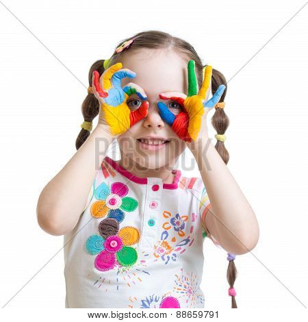 Four year old child girl with hands painted in color paints