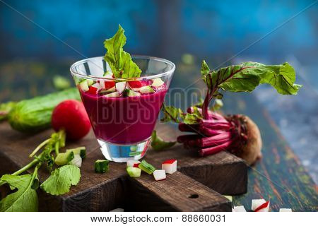 Beetroot gazpacho soup with cucumber and radish in  glass. Soft focus