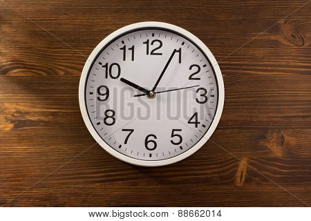 wall clock on wooden background