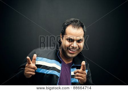 Happy Indian man pointing at you