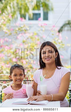 Mother And Daughter In The Cafe