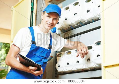 electrician engineer worker inspector in front of fuseboard equipment