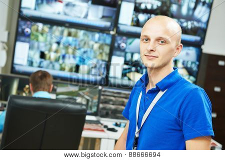 Portrait of security guard over video monitoring surveillance security system