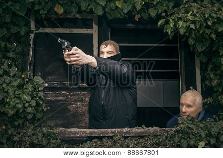 Masked Men With A Gun