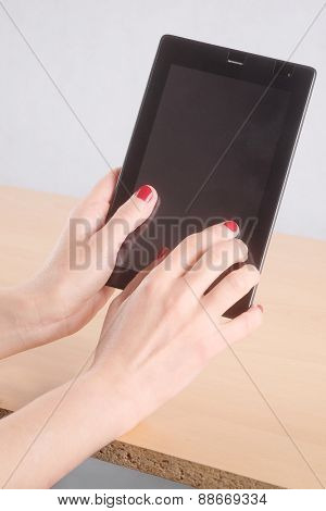 Woman using her black tablet