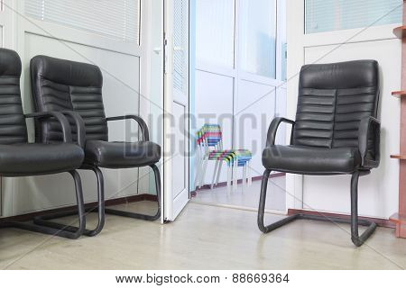 The corridor, waiting room with leather arm-chairs