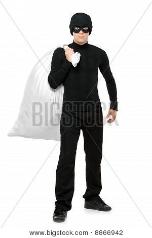 Full Length Portrait Of A Thief Holding A Bag