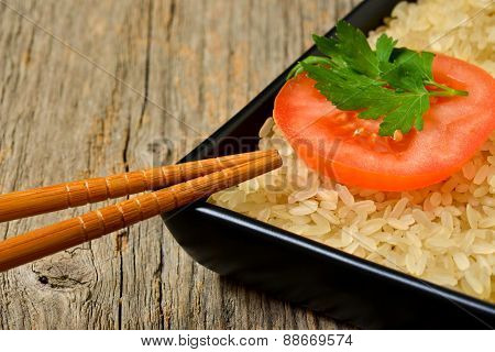 Plate With Rice And Tomato Slice