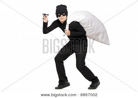 Robber With A Bag And Flashlight In Hands Isolated Against White Background