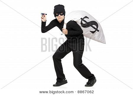 Thief With A Bag And Flashlight In Hands