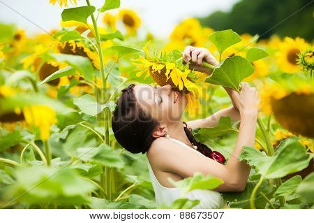 Happy Woman Having Fun In Field Full Of Sunflowers