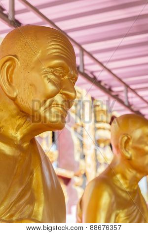 Golden Buddhism Monk Statue