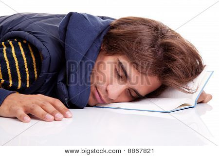 Young Man Lying Asleep On A Book, Isolated On White, Studio Shot