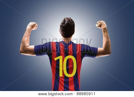 Soccer player on red and blue t-shirt on blue background