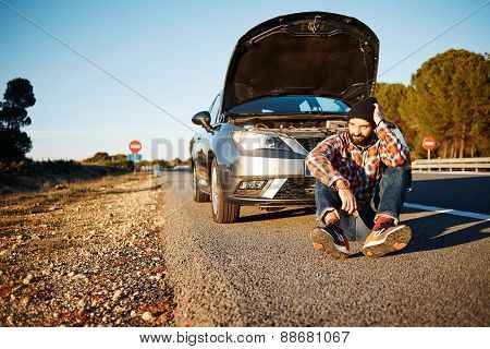 Car And Driver Man In Beautiful Sunny Landscape. Portrait Of Sad Man Thinking How To Repair Car