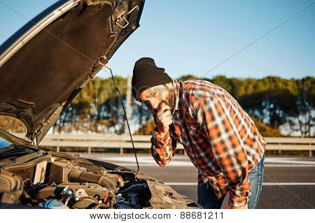 Car Driver - Young Man Stands A Thoughtful Expression Face And Looking At Camera On Road Trip