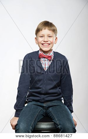 Portrait Of Young Smiling Cute Boy Laughing