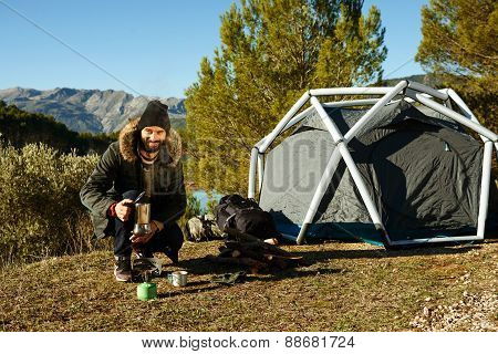 Hikers - People Hiking. Adventure Hiking Man Made Coffee On A Gas Stove In Open Air Near Mountain