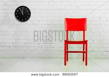 Red chair with clock