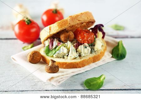 Tasty sandwich on wooden table, close up