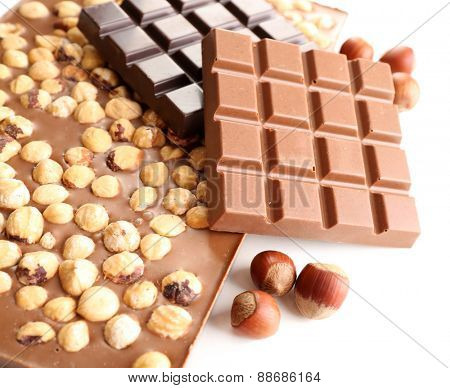 Black and milk chocolate bars with hazelnuts isolated on white