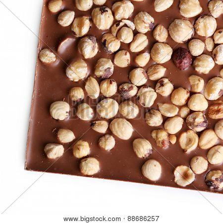 Milk chocolate bar with hazelnuts isolated on white