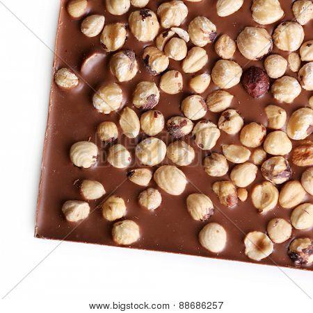 Milk chocolate bar with hazelnuts isolated on white