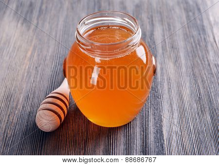 Delicious honey on table close-up