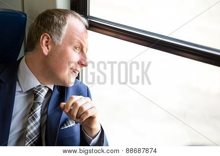 Businessman surprised what he sees through window