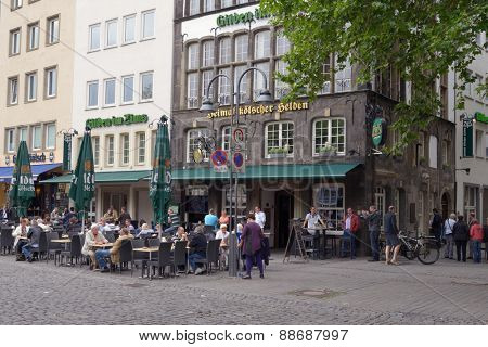 COLOGNE, GERMANY - JUNE 30, 2013: People resting in the street terrace of the restaurant Gilden in Zims. Founded in 1920, the restaurant was fully renovated in 2006-2009
