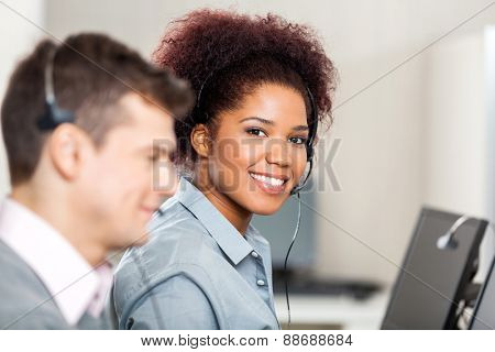 Portrait of smiling female customer service representative working in office