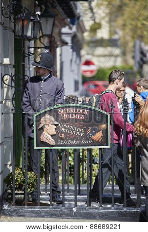 LONDON, UK - APRIL 22: An actor dressed in traditional English police uniform manages visitors to the Sherlock Holmes museum. April 22, 2015 in London.