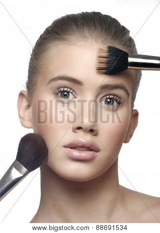 Woman face with cosmetic brush blusher on her face