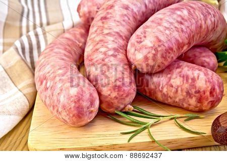 Sausages pork on board with napkin