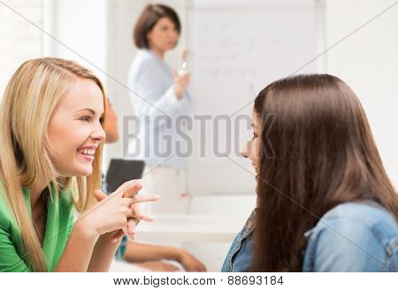 education concept - student girls gossiping at school