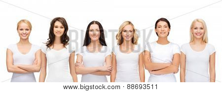 clothing design and people unity concept - group of happy smiling women in blank white t-shirts