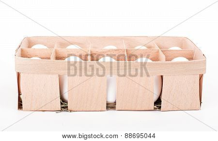 Organic White Eggs In Wooden Basket