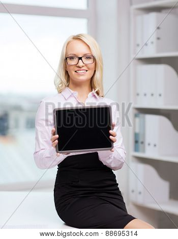 education, business and technology concept - smiling businesswoman or student showing tablet pc computer blank screen in office