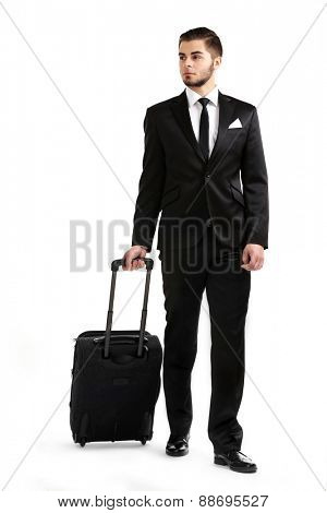 Elegant man in suit with suitcase isolated on white