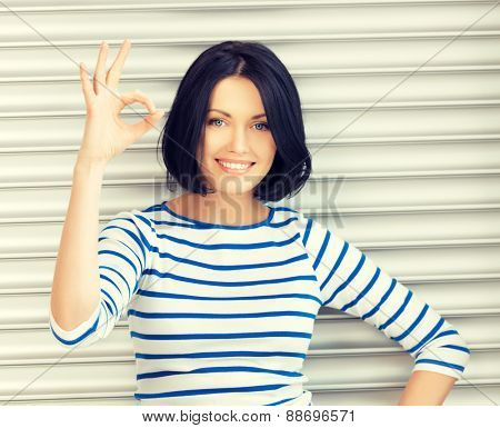 picture of happy teenage girl showing ok sign