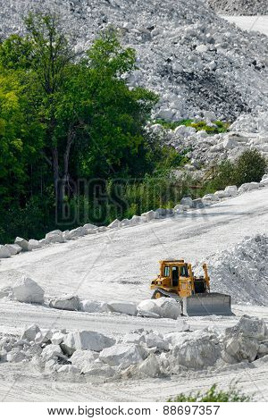 Bulldozer On White Road Of Marble Mine