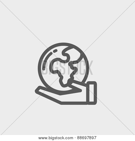 Hand holding earth icon thin line for web and mobile, modern minimalistic flat design. Vector dark grey icon on light grey background.