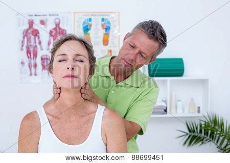 Doctor doing neck adjustment in medical office