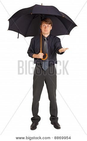 Person Protected By A Large Umbrella