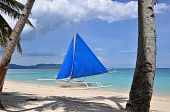 Traditional Paraw Sailing Boat On White Beach On Boracay Island