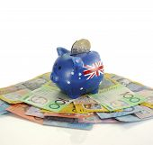 stock photo of year end sale  - Australian Money with Piggy Bank for saving spending or end of financial year sale - JPG