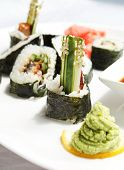 stock photo of soy sauce  - sushi with soy sauce - JPG