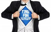 image of time study  - businessman showing Time for review words underneath his shirt over white background - JPG