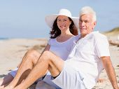 stock photo of couple sitting beach  - Couple sitting on the beach - JPG